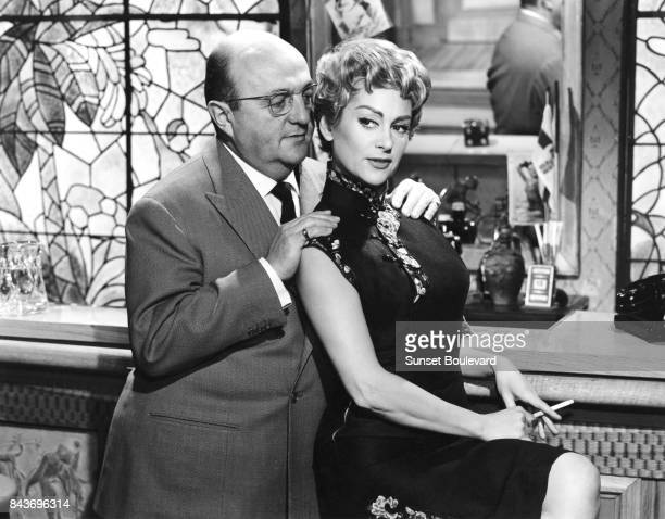 Bertrand Blier and Martine Carol on the set of Le cave se rebiffe directed by Gilles Grangier