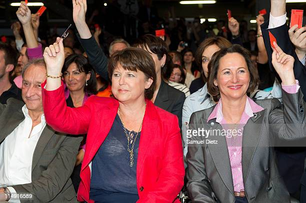 Bertrand Delanoe Martine Aubry and Segolene Royal vote with the audience at the French Socialist Party National Convention on May 28 2011 in Paris...