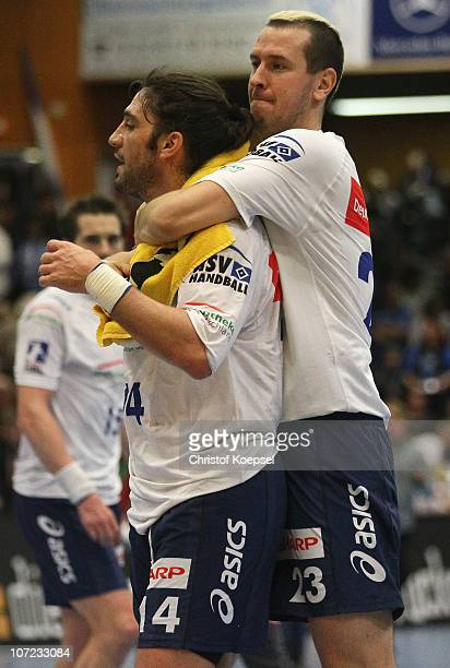 Bertrand Gille and Pascal Hens of Hamburg celebrate the 33-29 victory after the Bundesliga match between VfL Gummersbach and HSV Hamburg at the...