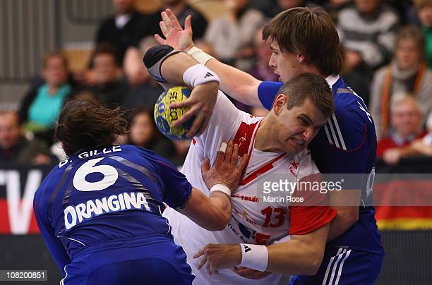 Bertrand Gille and Xavier Barachet of France is challenged by Julen Aguinagalde of Spain during the Men's Handball World Championship Group A match...