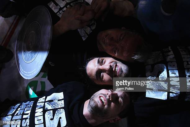 Bertrand Gille, Guillaume Gille and Pascal Hens of Hamburg celebrate the German championship after the Toyota Handball Bundesliga match between HSV...