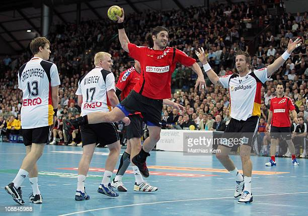 Bertrand Gille of All Star Team throws during a friendly game between Germany and the Handball Bundesliga Allstars at Arena on February 5, 2011 in...