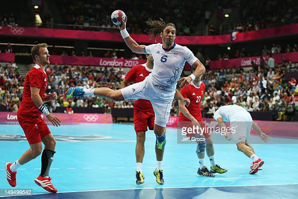 Bertrand Gille of France jumps to shoot during the Men's Handball preliminaries group A match between France and Great Britain on Day 2 of the London...