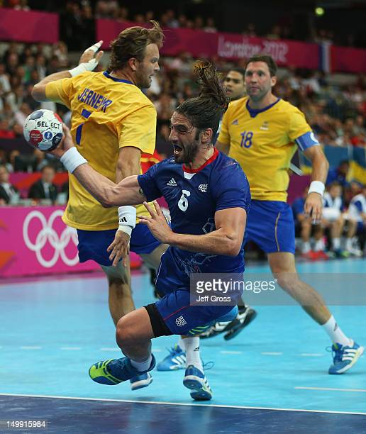Bertrand Gille of France jumps to shoot during the Men's Handball preliminaries group A match between France and Sweden on Day 10 of the London 2012...