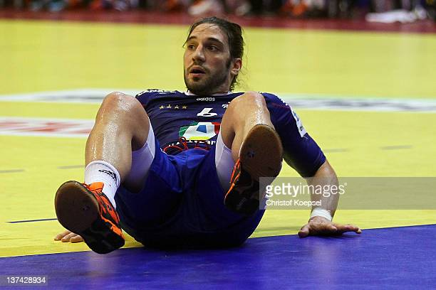 Bertrand Gille of France lies on the pitch during the Men's European Handball Championship group C match between France and Hungary at Spens Arena on...