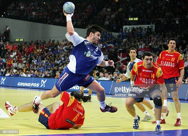 Bertrand Gille of France tries to score as Ruben Garabaya Arenas and Juan Garcia Marquez of Spain looks on during the European handball championships...