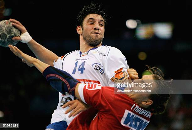 Bertrand Gille of Hamburg in action with Christoph Theuerkauf of Magdeburg during the Handball Bundesliga match between HSV Handball and SC Magdeburg...