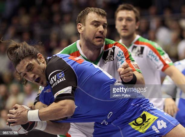 Bertrand Gille of Hamburg is attacked by Bartosz Jurecki of Magdeburg during the Toyota Handball Bundesliga match between SC Magdeburg and HSV...
