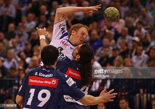 Bertrand Gille of Hamburg is challenged by Stefan Kneer of Grosswallstadt during the Toyota Handball Bundesliga match between HSV Hamburg and TV...