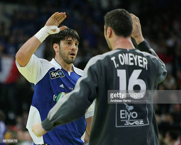 Bertrand Gille shakes hands with Golakeeper Thierry Omeyer of France during the European handball championships final between Spain and France at the...