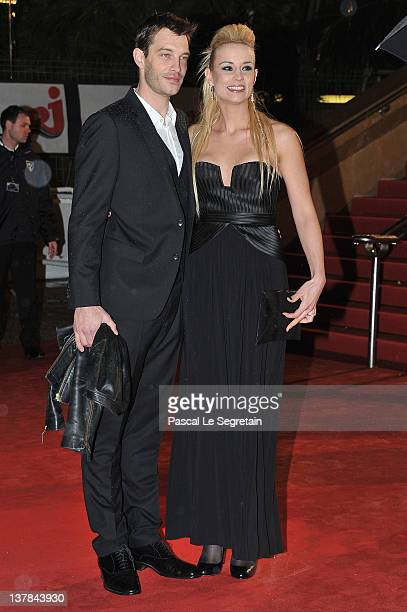 Bertrand Lacherie and Elodie Gossuin pose as they arrive at NRJ Music Awards 2012 at Palais des Festivals on January 28 2012 in Cannes France