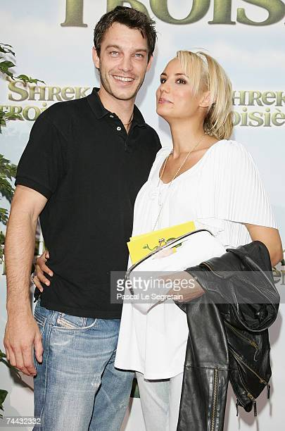 Bertrand Lacherie and Elodie Gossuin pose as they arrive to attend the premiere of Chris Miller's film Shrek 3 on June 7 2007 in Paris France