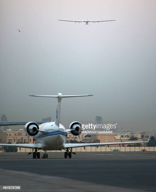 Bertrand Piccard one of the two Swiss pilots of the solarpowered plane Solar Impulse 2 lands at the Emirati capital Abu Dhabi's small AlBateen...