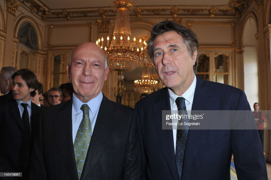 Bertrand Rindoff Petroff Officier des Arts et Des Lettres (L) and Bryan Ferry (R) pose at Ministere de la Culture on April 4, 2012 in Paris, France.