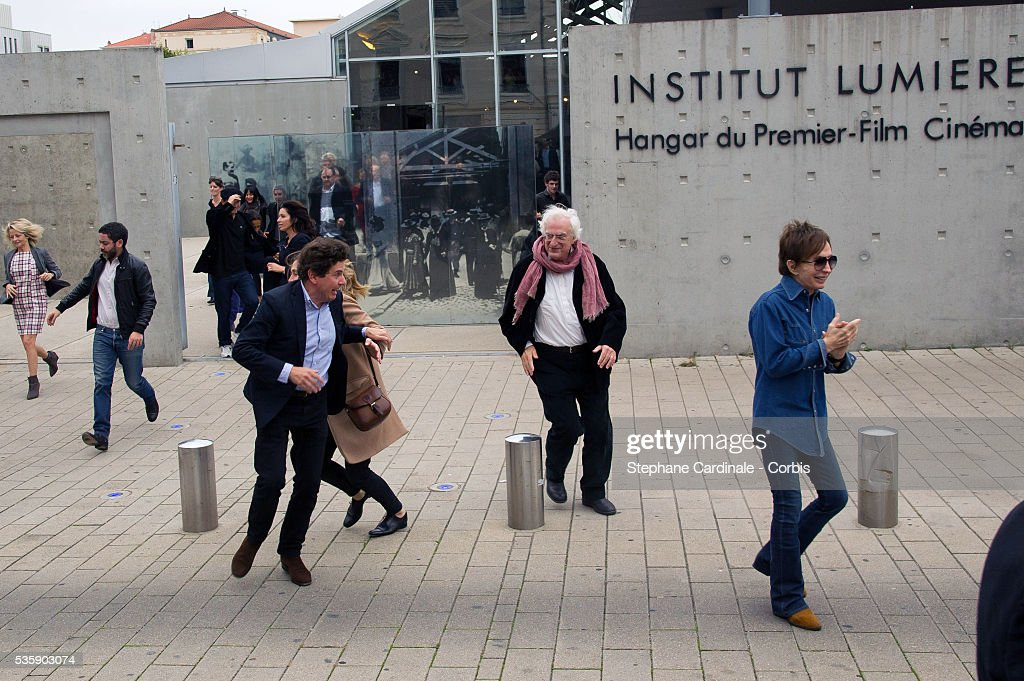 Bertrand Tavernier and Michael Cimino attend the Remake of the 1st Movie of the Lumiere Brothers , during the 5th Lumiere Film Festival, in Lyon.