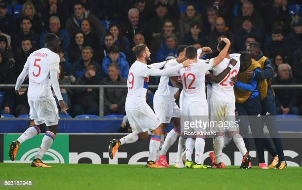 Bertrand Traoré of Lyon celebrates as he scores their second goal with team mates during the UEFA Europa League Group E match between Everton FC and...