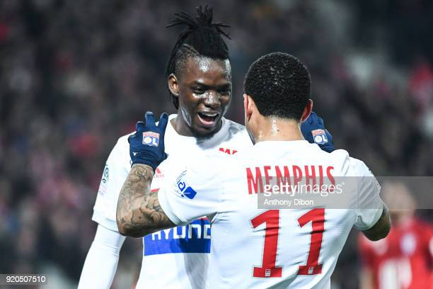 Bertrand Traore celebrates his goal with Memphis Depay of Lyon during the Ligue 1 match between Lille OSC and Olympique Lyonnais at Stade Pierre...
