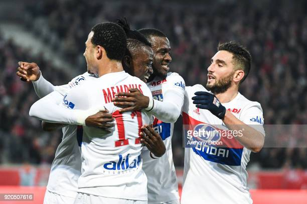 Bertrand Traore celebrates his goal with Memphis Depay Tanguy Ndombele and Jordan Ferri during the Ligue 1 match between Lille OSC and Olympique...