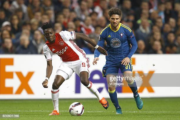 Bertrand Traore of Ajax Amsterdam Carles Planas of Celta de Vigoduring the UEFA Europa League group G match between Ajax Amsterdam and Celta de Vigo...