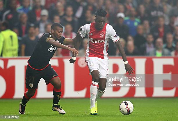 Bertrand Traore of Ajax is chalenged by Darwin Andrade of Standard Liege during the UEFA Europa League group G match between AFC Ajax and R Standard...