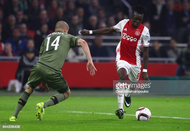 Bertrand Traore of Ajax is faced by Adam Hlousek of Legia Warszawa during the UEFA Europa League Round of 32 second leg match between Ajax Amsterdam...
