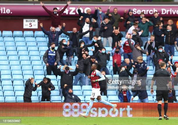 Bertrand Traore of Aston Villa celebrates after scoring their side's first goal during the Premier League match between Aston Villa and Chelsea at...