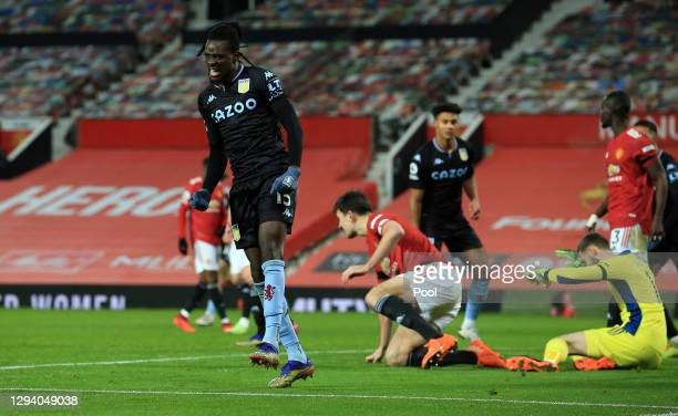 Bertrand Traore of Aston Villa celebrates after scoring their team's first goal during the Premier League match between Manchester United and Aston...