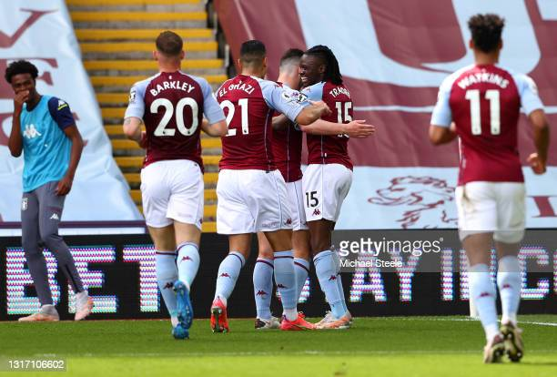 Bertrand Traore of Aston Villa celebrates with Anwar El Ghazi and JohnMcGinn after scoring their team's first goal during the Premier League match...