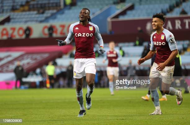 Bertrand Traore of Aston Villa celebrates with team mate Ollie Watkins after scoring their team's second goal during the Premier League match between...