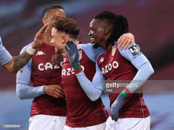Bertrand Traore of Aston Villa celebrates with team mates after scoring their team's second goal during the Premier League match between Aston Villa...