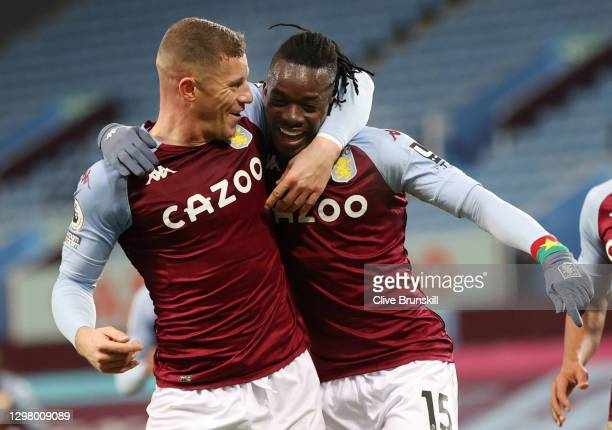Bertrand Traore of Aston Villa celebrates with teammate Ross Barkley after scoring their team's second goal during the Premier League match between...