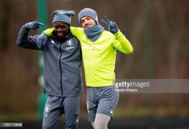 Bertrand Traore of Aston Villa in action with team mate Jack Grealish during training session at Bodymoor Heath training ground on December 22, 2020...