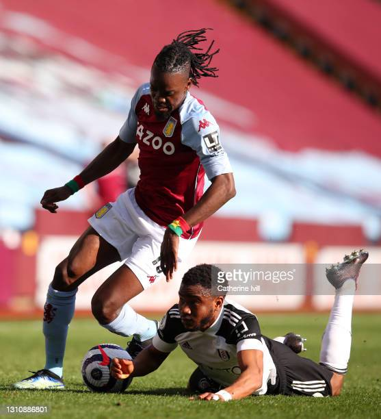 Bertrand Traore of Aston Villa is challenged by Ademola Lookman of Fulham during the Premier League match between Aston Villa and Fulham at Villa...