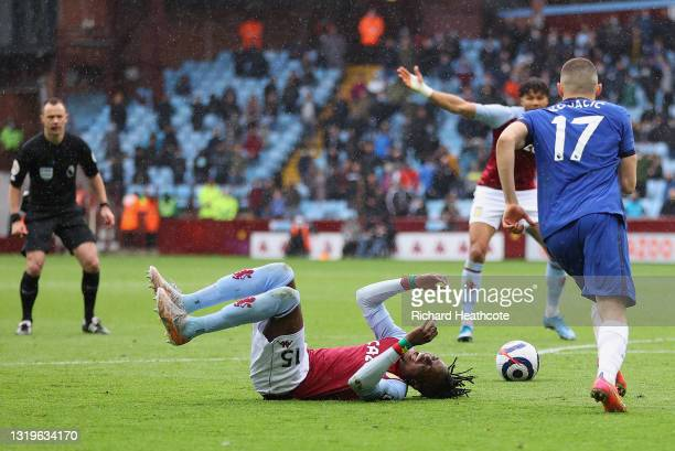 Bertrand Traore of Aston Villa is challenged by Mateo Kovacic of Chelsea leading to a penalty being awarded during the Premier League match between...