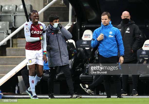 Bertrand Traore of Aston Villa is substituted off after falling over the advertising boards during the Premier League match between Newcastle United...
