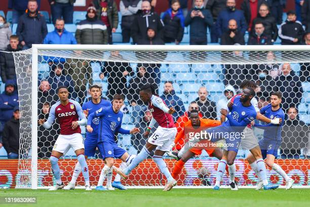 Bertrand Traore of Aston Villa scores their side's first goal past Edouard Mendy of Chelsea during the Premier League match between Aston Villa and...