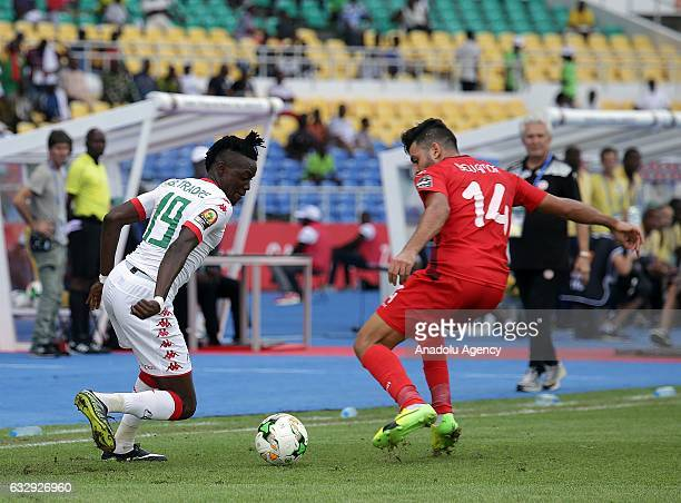 Bertrand Traore of Burkina Faso vies with Mohamed Amine Ben Amor during the 2017 Africa Cup of Nations quarterfinal football match between Burkina...