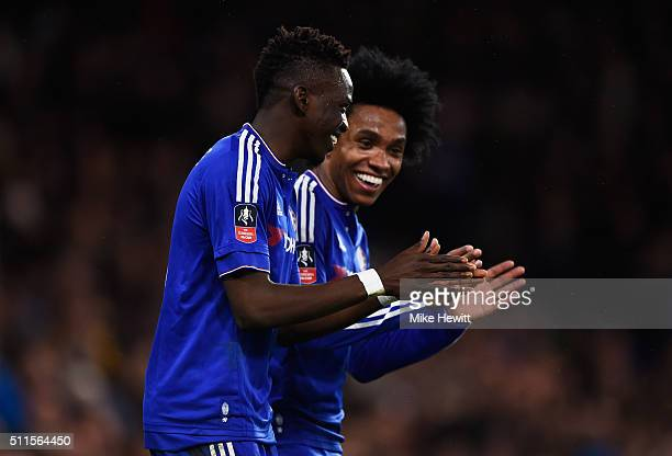 Bertrand Traore of Chelsea celebrates with teammate Willian after scoring his team's fifth goal during The Emirates FA Cup fifth round match between...
