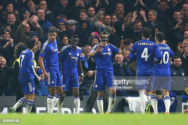 Bertrand Traore of Chelsea is congratulated by his team mates on scoring his team's fifth goal during the Barclays Premier League match between...