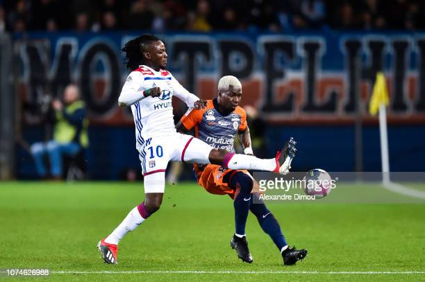 Bertrand Traore of Lyon and Ambroise Oyongo of Montpellier during the Ligue 1 match between Montpellier and Lyon at Stade de la Mosson on December 22...