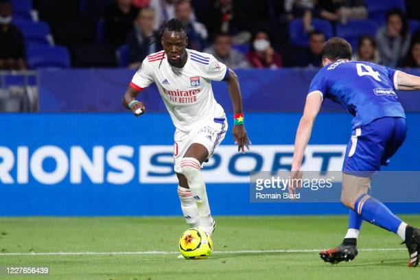 Bertrand TRAORE of Lyon and George EDMUNDSON of Rangers during the Veolia Trophy match between Lyon and Glasgow Rangers at Groupama Stadium on July...