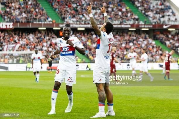 Bertrand Traore of Lyon and Memphis Depay of Lyon celebrates scoring his goal during the Ligue 1 match between Metz and Olympique Lyonnais at on...