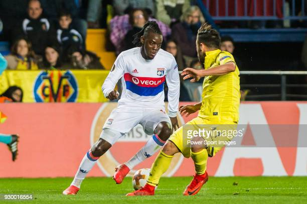 Bertrand Traore of Olympique Lyon is tackled by Jaume Vicent Costa Jorda J Costa of Villarreal CF during the UEFA Europa League 201718 Round of 32...