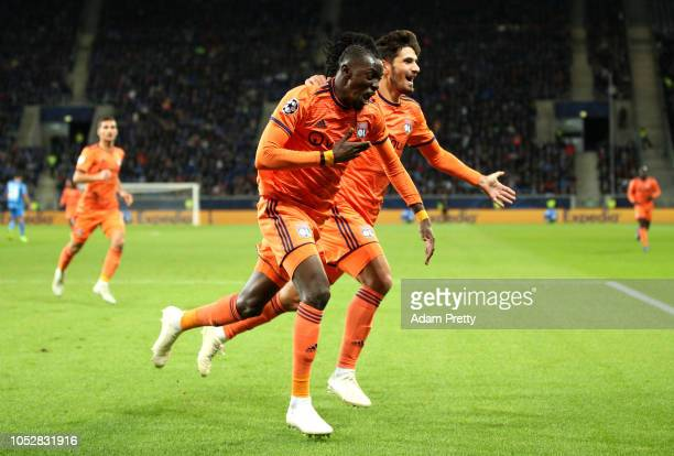 Bertrand Traore of Olympique Lyonnais celebrates after scoring his team's first goal during the Group F match of the UEFA Champions League between...