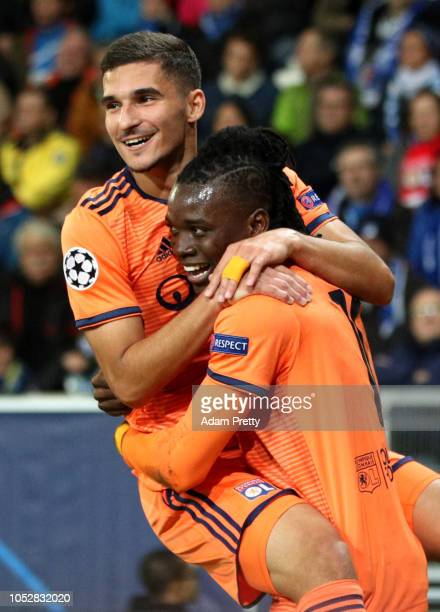 Bertrand Traore of Olympique Lyonnais celebrates after scoring his team's first goal with Houssem Aouar during the Group F match of the UEFA...