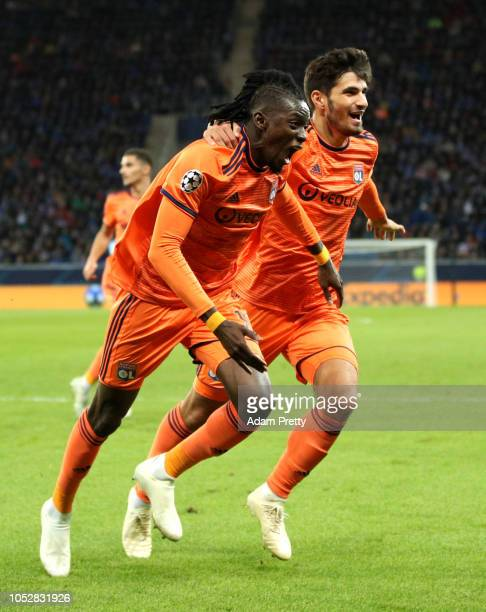 Bertrand Traore of Olympique Lyonnais celebrates with teammate Martin Terrier after scoring his team's first goal during the Group F match of the...