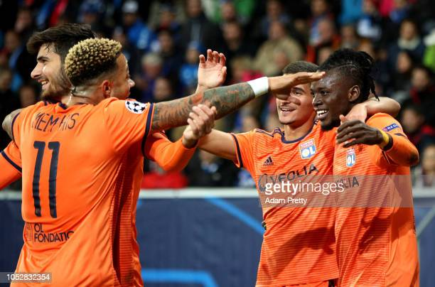 Bertrand Traore of Olympique Lyonnais celebrates with teammates after scoring his team's first goal during the Group F match of the UEFA Champions...