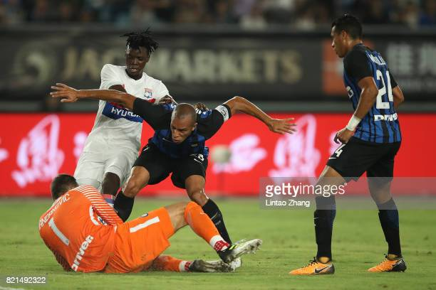 Bertrand Traore of Olympique Lyonnais competes for the ball with Samir Handanovic Joao Miranda and Jeison Murillo of FC Internationale during the...