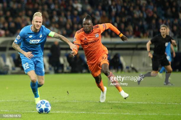 Bertrand Traore of Olympique Lyonnais wins the ball from Kevin Vogt of 1899 Hoffenheim before going on to score his team's first goal moments later...