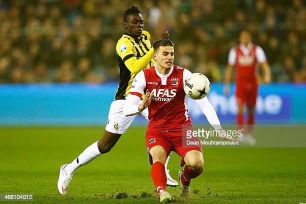 Bertrand Traore of Vitesse and Wesley Hoedt of AZ battle for the ball during the Dutch Eredivisie match between Vitesse Arnhem and AZ Alkmaar held at...